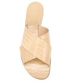 Simple design is enlivened by a bold all-over texture effect resembling embossed crocodile leather. These flat sandals feature two chunky leather straps and a stacked leather sole. Made in Italy.
