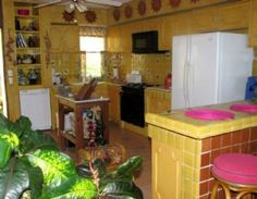 Mexican kitchen decoration- yellow walls with red appliances?