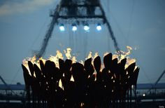The Olympic Flame is seen before the start of the Closing Ceremony