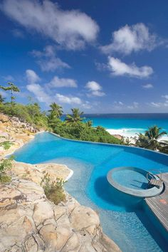 Browse swimming pool designs to get inspiration for your own backyard oasis. Discover pool deck ideas and landscaping options to create your poolside dream Les Seychelles, Seychelles Islands, Seychelles Africa, Fiji Islands, Cook Islands, Amazing Swimming Pools, Cool Pools, Spas, Beautiful Pools