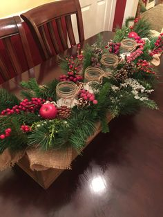 Wooden box Christmas centerpiece, rustic with burlap, greenery, berries, pine cones, mason jars. Farmhouse decor.