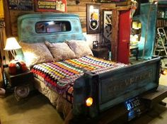 Truck Bed bed made from a truck - different from most I've seen this one doesn't use the full truck bed but just the end as a footboard and the back of the cab as a headboard