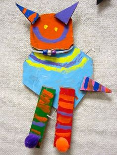Kindergarten students looked at assemblage sculptures by two famous artists, Alexander Calder and Deborah Butterfield. They created their own animals or creatures by assembling and using cardboard, wire, paint and beads.
