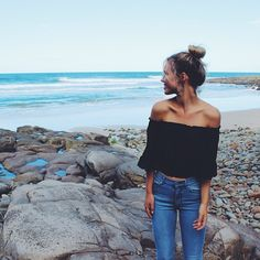 black off the shoulder summer top, messy bun, faded blue jeans