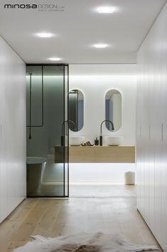 Modern white bathroom design in this New York apartment! Corian® sinks look beautiful.