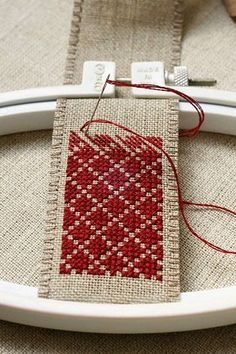 Hold a small piece of work with an embroidery hoop. Less stress on the fabric. : Hold a small piece of work with an embroidery hoop. Less stress on the fabric. Cross Stitch Designs, Cross Stitch Patterns, Cross Stitching, Cross Stitch Embroidery, Cross Stitch Bookmarks, Thread Spools, Hand Embroidery Patterns, Embroidery Fabric, Needlework