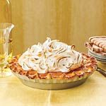 Sweet Potato Pie with Marshmallow Meringue | Wow guests this weekend with a sky-high marshmallow meringue on this sweet potato pie. Be sure to lightly pack the mashed sweet potatoes in your measuring cup for a fluffy filling.