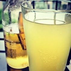 Cool down this #summer with this lightened up spiced ginger beer-ade. Fresh ginger light beer and a naturally sweetened lemonade make this drink a refreshing complement to any hot day! #sippinskinny #lowcarb #recipe #thirstythursday  Summer Shandy: Ginger Beer-ade  Serves: 2 Serving Size: 16oz  Ingredients 3oz vodka 1/4-inch piece fresh ginger (peeled) 12oz naturally sweetened light lemonade 1T fresh squeeze lemon juice ice 12oz Corona light (or preferred light beer) Natural sugar free…