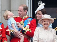 June 13, 2015 - Prince George of Cambridge is held by Prince William, Duke of Cambridge as Catherine, Duchess of Cambridge and Queen Elizabeth II look out from the balcony of Buckingham Palace during the Trooping The Color.