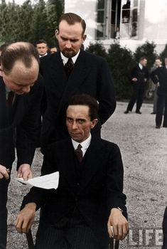 Nazi Minister of Propaganda Joseph Goebbels scowls at a Jewish photographer, 1933  Colorized-Historical-Photos-