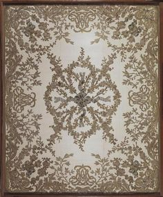 Fabric that was part of a quilt for Marie Antoinette's bed at Versailles. It features her monogram intertwined with Ls for Louis XVI.