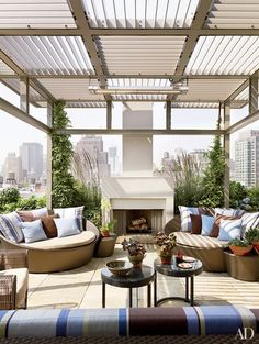 Edward Siegel created the trellis and fireplace for the rooftop terrace above the master bedroom of a Manhattan apartment | archdigest.com