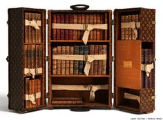 I would love to have a traveling library suitcase like this instead of my ratty backpack.
