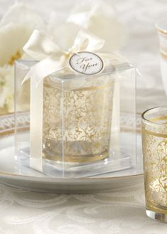 "Say ""Thank You"" with Style! This magnificently designed, clear-glass tealight holder #wedding #favor features an intricate filigree motif that glistens like gold. David's Bridal Style 20120GD"
