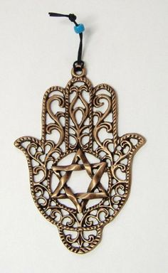 """Copper Tone Evil Eye HAMSA Judaica Israel Kabbalah Gift by Body-Soul-n-Spirit Hamsa Wall Hanging. $5.97. Hamsa Wall Hanging for """"Success & Protection""""    It is believed that the one who hangs a hamsa in their house will receive divine protection from the EVIL EYE that will in turn create positive energy, happiness, prosperity and good health.    The Hamsa is an ancient symbol picturing an opened hand with a palm and five outstretched fingers."""