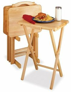 """5pc TV Table Set, Rectangular by HFD. $81.96. LxWxH: 19.05""""x14.56""""x25.98"""". Color: Natural. Solid wood. With smooth, broad tops, these solid wood TV Tables can easily hold a large meal, and the upright stand stores them discretely when not in use.. Save 41% Off!"""