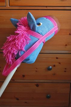 """Figuring out how to make a stick horse has been on my to do list for quite a while now, so I was thrilled to run across this amazing tutorial. The best part about it is that a) it's made from old jeans b) it's infinitely customizable and c) the creator of the tutorial is one of the best tutorializors out there. Ok, that's three """"best parts"""" and one made up word, but, really, that's how awesome this tutorial is."""