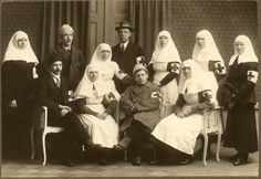 in 1918, Finnish nurses had a similar uniform, but favored the more nun-like, long head covering.
