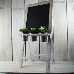 New blackboard with pots. Perfect for weddings, don't you think? http://www.thesatchvillegiftcompany.co.uk/products/new-for-spring-and-summer-2015/wooden-display-stands/wd350036.new-blackboard-with-plant-pots