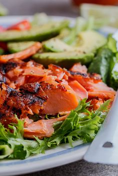 Spicy grilled trout salad with a zesty sriracha-lime dressing.