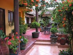 A courtyard is an excellent spot for your outdoor dining space, particularly with the greater privacy and intimacy that only an enclosed space can offer. If your courtyard connects to your house off of your dining space, make the most… Continue Reading → Mexican Courtyard, Mexican Patio, Spanish Courtyard, Mexican Garden, Courtyard House, Mexican Hacienda, Mexican Tiles, Hacienda Homes, Hacienda Style