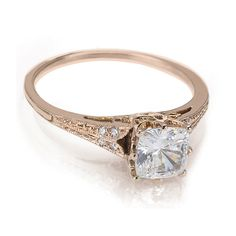Vintage engagement ring, cushion cut diamond, exquisite and tasteful