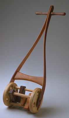 wood clacker lawn  mower-- beautifully crafted wooden toys made in Wisconsin