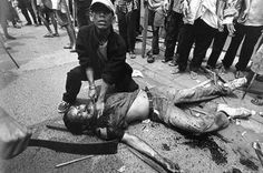 This photographer captured one man slicing the neck of another man in the 1998 riots in Indonesia.