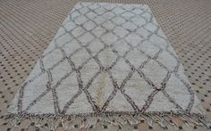 Lovely vintage Beni Ouarain carpet densely knotted with a field in ivory and…