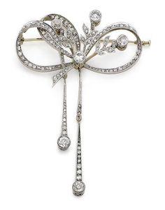 A diamond brooch/pendant, circa 1910 The rose-cut diamond knot, encircling similarly-cut diamond sprays, terminating in millegrain collet-set old brilliant-cut diamonds, suspending two uneven rose and single-cut diamond lines, each terminating in a collet-set old brilliant-cut diamond, old brilliant and single-cut diamonds approx. 2.20cts total, length 8.5cm