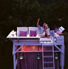 Turn an old bunk bed into a sun deck by day and a place to stare at the stars by night.  Love this idea!