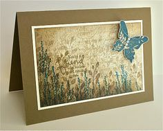 collaged card in browns with a blue butterfly...luv how the background was built up with layers of sponging and stamping...