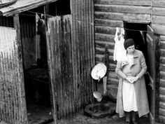 May 1936: This Collingwood house with a corrugated iron 'bathroom' and external tap as the only water supply, was rented out for around $1.25 per week.