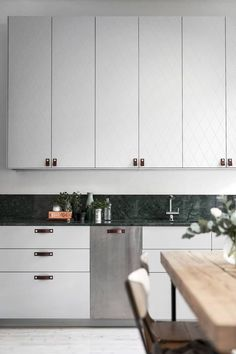 Cozy home with a green marble kitchen - via Coco Lapine Design