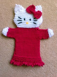 Free Knitting Pattern for Hello Kitty Hand Puppet - Cat hand puppet knit in DK yarn. Designed by Janet McGregor The Puppet Lady