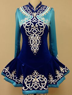 Lovely upper bodice embroidery. Nice color scheme. Like the detailing on the skirt. Not sure about the shoulders. I don't like the skirt styling/shape as much as others.