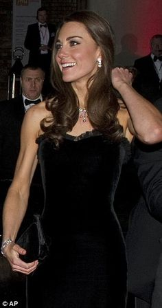 Catherine, Duchess of Cambridge [Catherine Elizabeth Middleton Mountbatten-Windsor] in a £4,000 black strapless dress by her favourite couture label, Alexander McQueen.