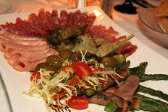 Proscuitto wrapped asparagus with assorted antipasto at Francesco's.  visit: francescos.com