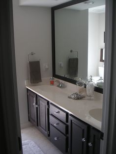 contrast of gray and dark chocolate painted oak cabinets