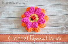 Crochet Popcorn Flower - Free Pattern & Photo Tutorial www.thestitchinmommy.com. ﻬஐCQஐﻬ #crochet #spring #crochetflowers #flowers  http://www.pinterest.com/CoronaQueen/crochet-leaves-and-flowers-corona/