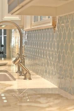 Pale blue Moroccan tile backsplash with white grout. I love this pattern!!