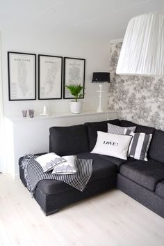 light floor, dark couch, toile wall-paper, frames - like it all!