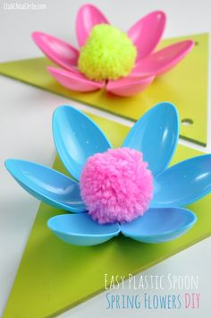 Easy Spring Flower Plastic Spoon Garland Craft Idea and Tutorial  - make super simple flowers with colored spoons and a little glue, add a pom pom center, and these are the perfect Spring home decor craft idea!