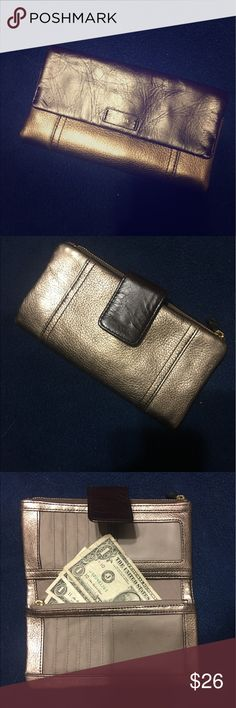 Fossil wallet 📌NWOT Fossil Wallet📌 It's dark brown and gold in color with plenty of room for your credit cards, money & loose change!  Bought 3 or so months ago & never used it.  Lost the receipt so I couldn't take it back, so my loss is your gain 🎯 original price was $69 😳 Fossil Bags Wallets