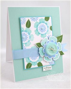 I have a new Papertrey Ink color combo that I'm loving, borrowed from Heather's new Green Boutique Papers--Aqua Mist, Spring Rain, New Leaf, and a touch of Hawaiian Shores. I used the stamps and coordinating flower dies from Beautiful Blooms II, as well as a tag from Mixed Messages. Ribbon is Spring Rain, and Vintage Button is Aqua Mist. The mat layer is Hawaiian Shores--a perfect color to accent Aqua Mist! I had several options for decorating that Aqua Mist background, but I decided that it…