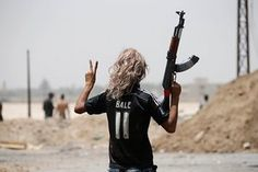 A member of the Iraqi government forces celebrates after they recaptured the city of Falluja from Islamic State militants