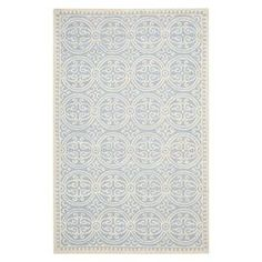 "Anchor your living room seating group or define space in the den with this artfully hand-tufted wool rug, showcasing a scrolling medallion motif for eye-catching appeal.  Product: RugConstruction Material: WoolColor: Light blueFeatures:  Hand-tuftedMade in IndiaPile Height: 0.63"" Note: Please be aware that actual colors may vary from those shown on your screen. Accent rugs may also not show the entire pattern that the corresponding area rugs have.Cleaning and Care: Professional cleaning ..."