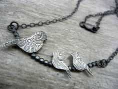 Mommy bird necklace with her two little ones. $68.00, via Etsy.