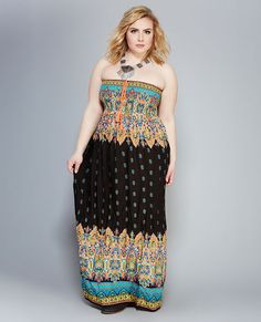 "<p>Bring out your summer style with this hippie chic dress! Perfect for the pool or the beach, it features a woven body, a bright paisley print, a smocked bodice, and a self-tie tassel at the front.</p>  <p>Model wears a size 1X.</p>  <ul> 	<li>Tube Top</li> 	<li>Strapless</li> 	<li>Pull-on Construction</li> 	<li>Unlined</li> 	<li>49.5"" From Top to Hem</li> 	<li>Rayon</li> 	<li>Hand Wash</li> 	<li>Imported</li> </ul>"