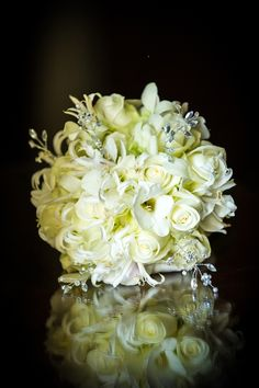 Carefully chosen white and ivory flowers for this delicate hand tied bouquet with diamante and crystal detailing